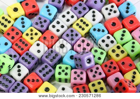 Background Of Many Colored Gaming Dice With Black Dots