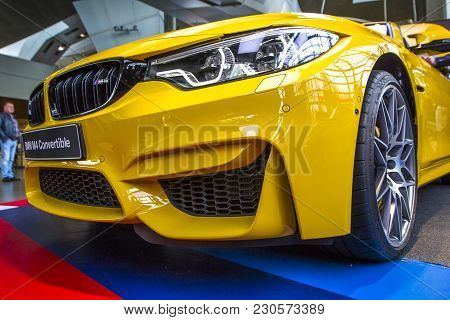 Munich, Germany - November 1, 2017: Yellow Sports Car Bmw M4 On Exhibition Center Bmw Welt In The Ol