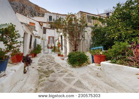 Traditional White Houses On A Narrow Street In The Historic Plaka Area. Athens. Greece.