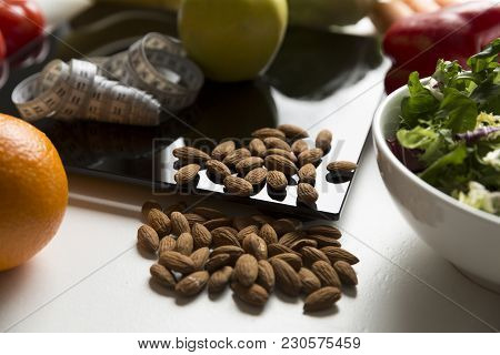 Healthy Fruit,vegetables And Nuts, Scales And Measuring Tape. Weight Loss And Right Nutrition Concep