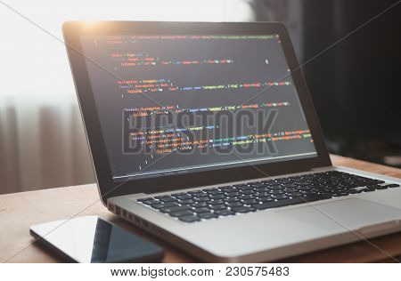Computer Code On Laptop (web Developing) And Mobile Smart Phone In Sunlight