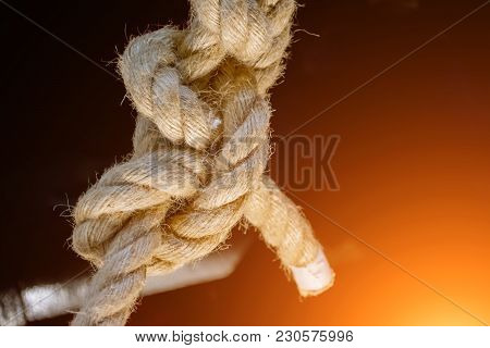 Sea Knot Is A Thick Rope, On A Black Background