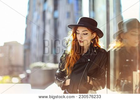 Pretty girl with fashionable clothes