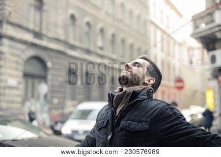 Satisfied businessman breathing in