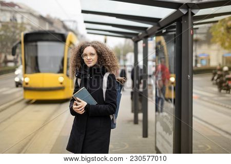 Girl waiting at the bus stop