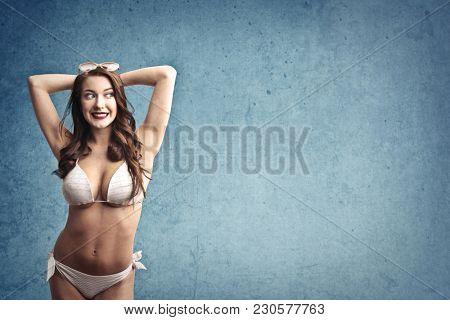 Smiling woman wearing a bikini