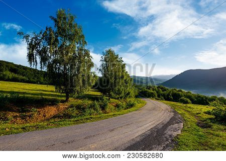 Countryside Road In Mountains. Beautiful Landscape On Fresh Summer Morning