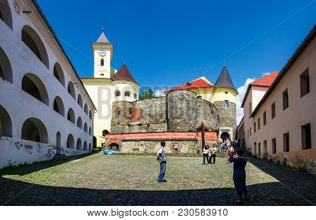 Mukachevo, Ukraine - May 25, 2008: Panorama Of Palanok Castle Courtyard With Clock Tower. Old Fortif