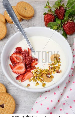 Chilled Buttermilk Soup From Greek Yogurt With Strawberries And Pistachios, Cashews. Serve With Cris