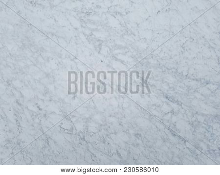 A closeup of a greyish-white granite texture.