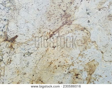 A closeup of a natural granite slab surface.