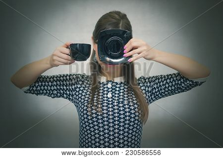 Coffee Break. Coffee Time. Lunch Break. Woman Holding In Hands A Cup Of Coffee And Hides Her Face Be