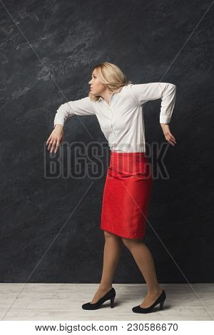 Portrait Of Business Woman Playing Marionette, Shot Over Grey Background. Manipulation, Dictatorship