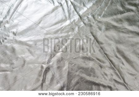 Silvery Golden Fabric Texture Background. Smooth Elegant Or Satin Luxury Cloth Texture Can Use As We
