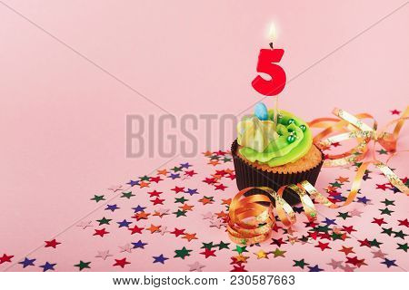 Fifth 5th Birthday Cupcake With Candle And Sprinkles On Pink Background. Card Mockup, Copy Space. Bi