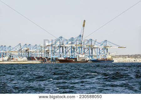 Loading Of Bulk Carriers Against The Background Of A Large Number Of Bridge Cranes