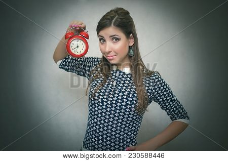 Happy Woman Holding In Hands Red Alarm Clock. Come To Work On Time Concept. Time Reminder. Punctual