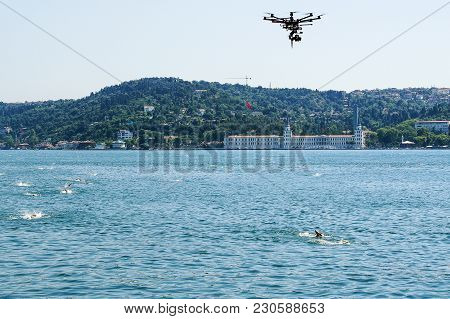 Quadcopter Removes A Heat On Open Water Of Swimmers Through The Bosphorus Strait. Summer In Istanbul