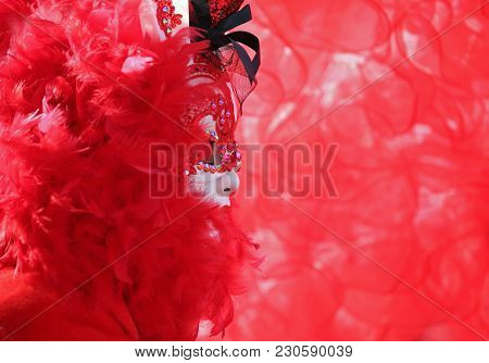 Gorgeous Costume With White Mask And Background All Red At A Carnival Party