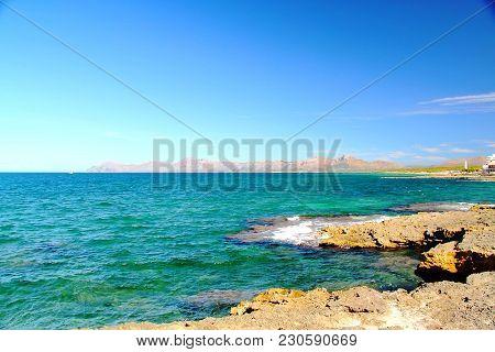 Turquoise Sea Water And Blue Sky. Beautiful Background. Spain. Palma De Majorca