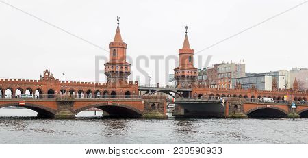 Oberbaum Bridge Over River Spree In Berlin City, Germany