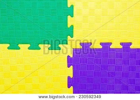 Close-up Of Baby Playing Mat Background.  Jigsaw Soft Rubber Surface Texture. Foam Floor Children Ma