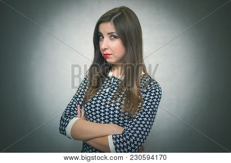 Offended And Resentful Woman Waiting For Excuses And Explanations Isolated On Gray Background.