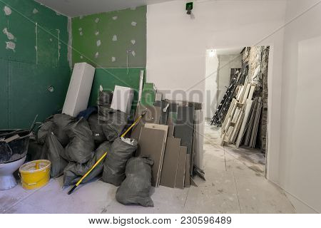 Construction Garbage In The Room With Plasterboard Or Drywall In The Bags Are An Apartment During On