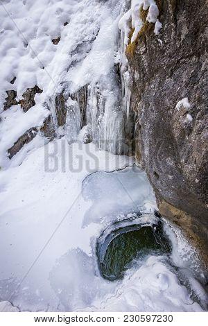 Frozen Icy Waterfall In Snow Covered Gorge Baerenschuetzklamm In Winter Near Town Mixnitz In Styria,