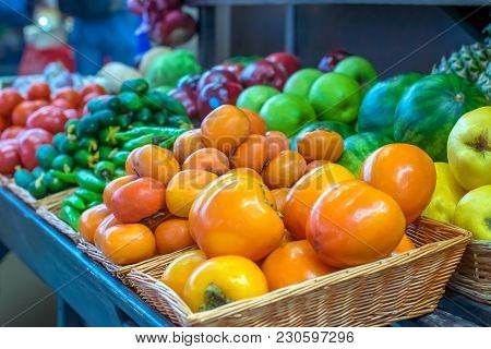 Juicy Fresh Fruit, Persimmons And Tangerines Are Sold At The Counter Green Market As Well As Apples