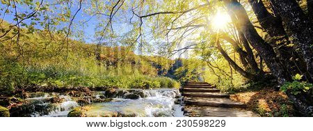 View Of Waterfalls And Pontoon In The Sunshine In Plitvice National Park, Croatia