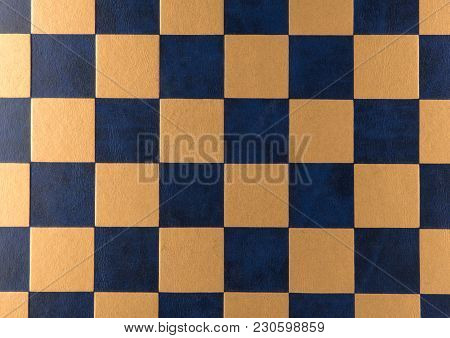 Chess Board. Leather Checkered Texture Background Of Blue And Gold Color