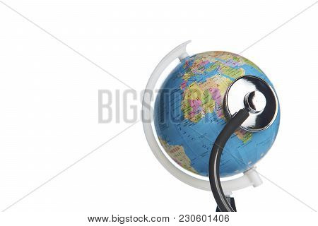 Green Earth Day, Save The Wold And Global Healthcare Concept. Medical Stethoscope Wrapped Around Glo
