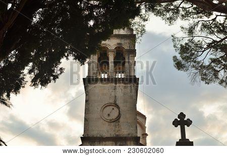 Belfry Of An Old Monastery In A Summer Landscape