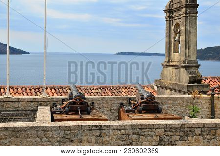 Belfry And Cannons As Parts Of A Medieval City Fortification As A Protection Against Attacks Coming