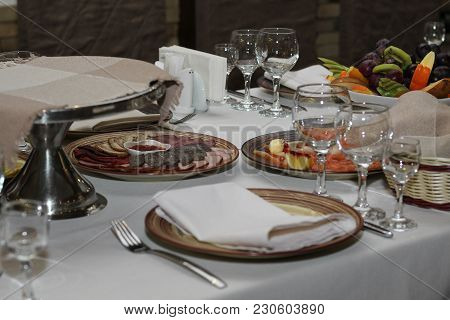 Served Table In Cafe Or Restaurant, Dishes With Meat And Fruit Close-up