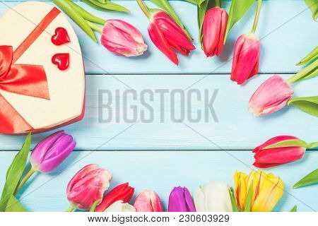 Colorful Spring Tulip Flowers With Decorative Giftbox And Hearts On Light Blue Wooden Background As