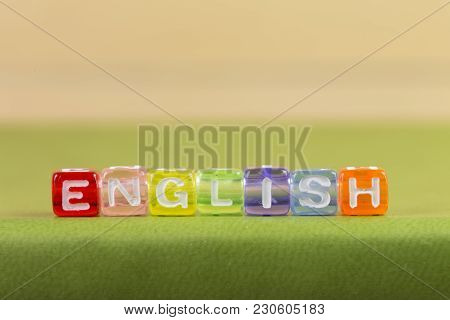Color Cube Figure With Word English On Green Book