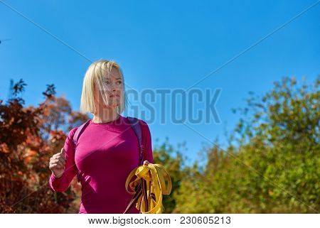 Portrait Of Young Athletic Woman With Suspension Straps In Park