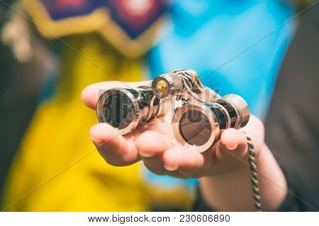 Theater Concept. Vintage Binoculars In Female Hand In Theatre Or Opera.