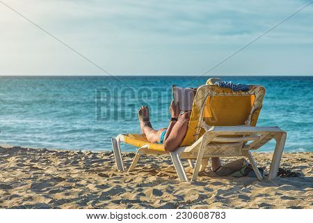 Enjoying The Sea And Sun. Funny Looking Man Tanning On The Beach