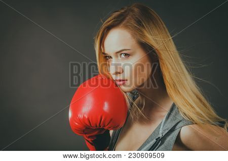 Young Sensual Woman, Blonde Attractive Girl Wearing Red Punch Boxing Gloves. Sport Fitness And Power