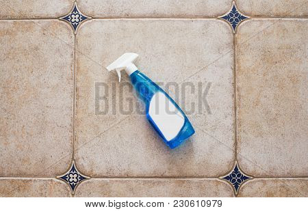 Bottle Of Window Cleaner For Windows And Mirrors Lies On The Tile, Space For Text