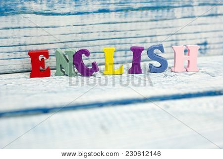 English Word Composed From Colorful Abc Alphabet Block Wooden Letters, Copy Space For Ad Text. Educa