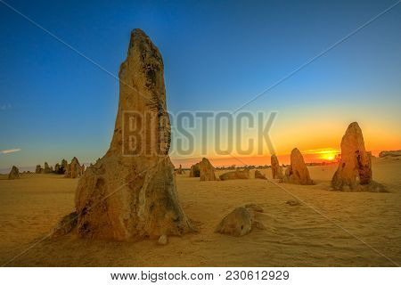 Giant Limestone Formation At Dusk. The Pinnacles Desert In Nambung National Park, Offers, At Sunset,