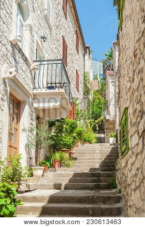 Narrow Stairs Alley With Residential Masonry Houses In Hvar, Croatia.