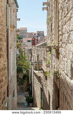 Typical Narrow Alleys And Buildings In Old Heritage Town Hvar, Croatia.