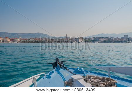 Sailing Towards Split In Croatia. View At Seafront Line Of Town.