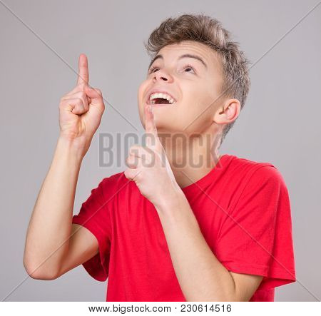 Emotional Portrait Of Excited Teen Boy. Funny Cute Surprised Child 14 Year Old With Mouth Open In Am