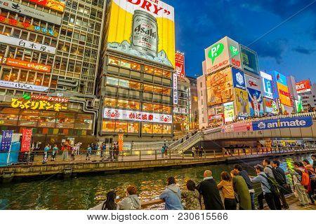 Osaka, Japan - April 29, 2017: People In Dotonbori Osaka, Namba District, In Blue Hour Shot. The Dot
